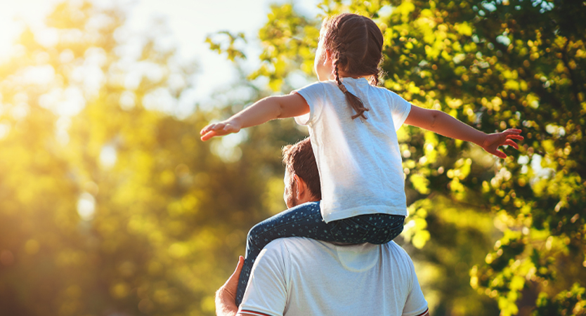Father with daughter on shoulders.
